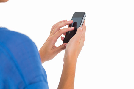 lady on phone: Woman sending a text message on white background Stock Photo