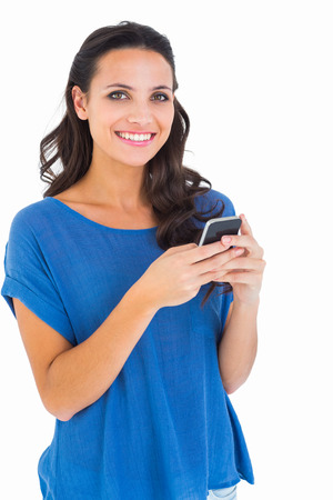 cut out device: Pretty brunette sending a text on white background Stock Photo