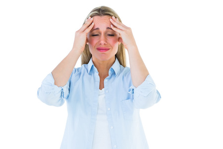 Portrait of a blonde getting a headache on white background