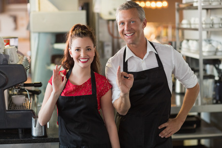 restaurant industry: Servers smiling at the camera at the cafe