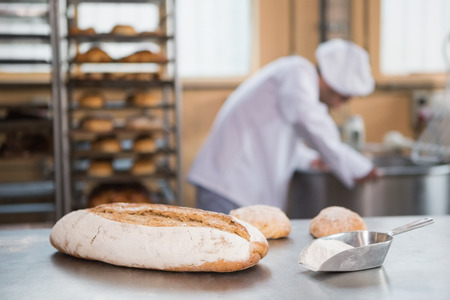bakery store: Baker preparing dough in industrial mixer at the bakery Stock Photo