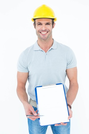 Portrait of confident architect holding clip board over white background photo