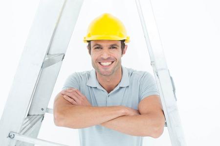 step ladder: Portrait of happy carpenter leaning on step ladder over white background