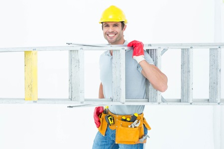 step ladder: Portrait of confident worker carrying step ladder over white background