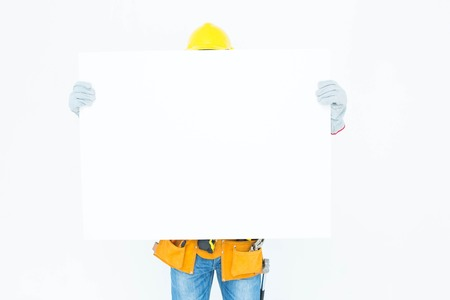 bill board: Portrait of male architect with bill board over white background