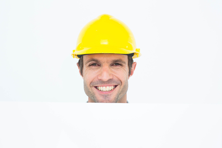 bill board: Portrait of happy male architect with bill board over white background