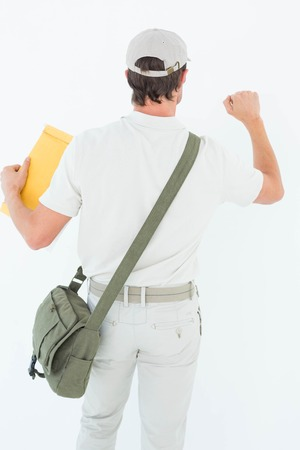 knocking: Rear view of delivery man with envelop knocking on white background