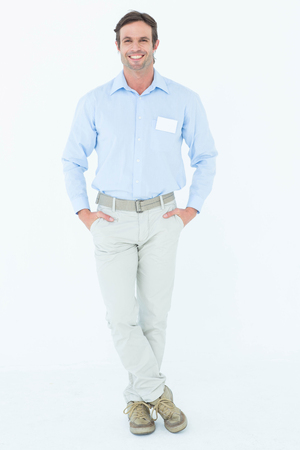 caucasian white: Portrait of confident businessman with hands in pockets standing against white background Stock Photo