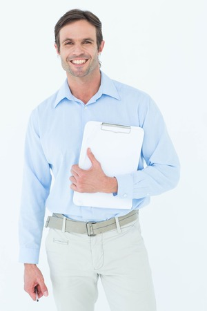 Portrait of confident supervisor holding clipboard over white background photo