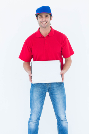 pizza box: Portrait of happy delivery man holding pizza box on white background