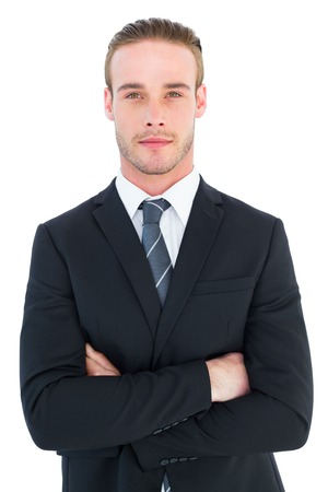 frowning: Frowning businessman looking at camera on white background