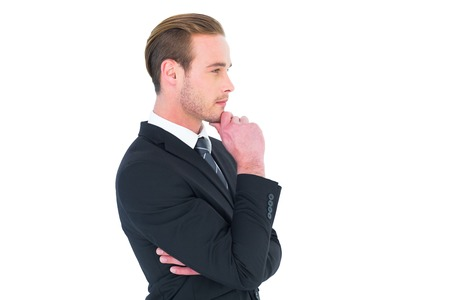 chin: Thinking businessman standing with hand on chin on white background Stock Photo