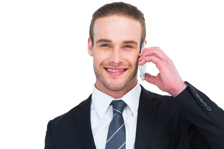 phoning: Portrait of a happy businessman phoning on white background