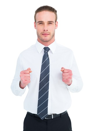 unsmiling: Unsmiling businessman presenting his fists on white background Stock Photo