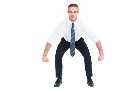 wincing: Businessman bending and lifting on white background