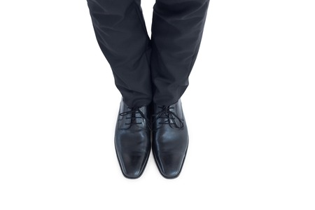 brogues: Businessmans feet in black brogues on white background