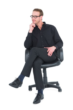 office chair: Thoughtful businessman sitting on a swivel chair on white background