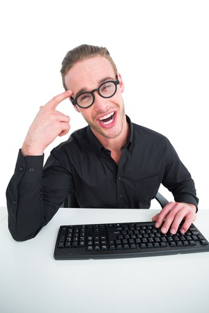 making a face: Businessman making a face and typing on keyboard on white background