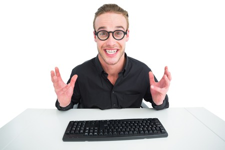 making a face: Businessman in shirt making a face at desk on white background