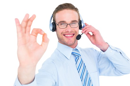 center agent: Businessman with headset making okay sign on white background