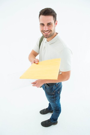 envelop: Full length portrait of happy derivery man giving envelop on white background