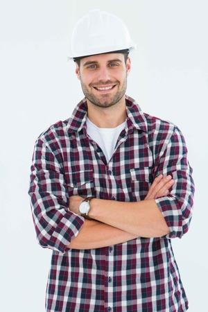 handome: Portrait of handome male handyman standing arms crossed on white background