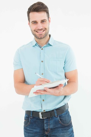 handome: Portrait of handome delivery man writing on clipboard on white background Stock Photo