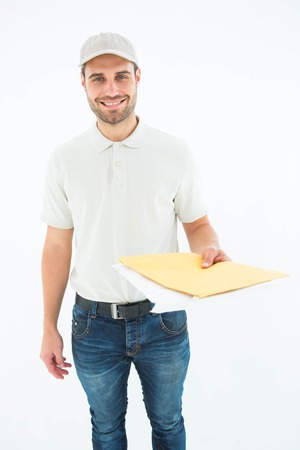 envelops: Portrait of happy delivery man giving envelops on white background Stock Photo