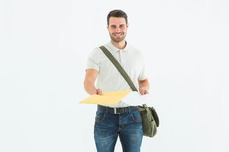 envelops: Portrait of happy courier man giving envelops on white background