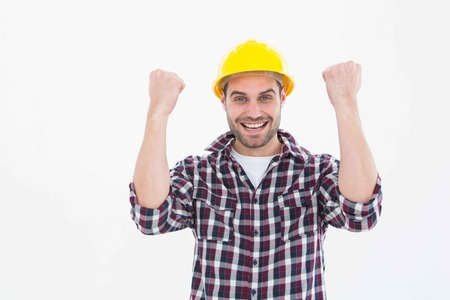 clenching fists: Portrait of successful male handyman clenching fists on white background Stock Photo