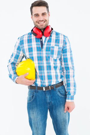 ear muffs: Portrait of confident manual worker with hardhat and ear muffs on white background Stock Photo