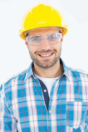 protective glasses: Portrait of confident repairman wearing protective glasses on white background Stock Photo