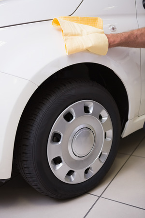 rag wheel: Close up of man cleaning his car at new car showroom Stock Photo