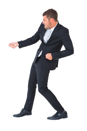contorted: Businessman contorted with hands out on white background