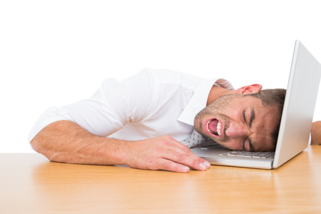 Businessman screaming put his head on laptop on white background