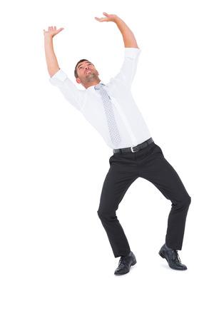 Businessman bending and pushing on white background Stock Photo