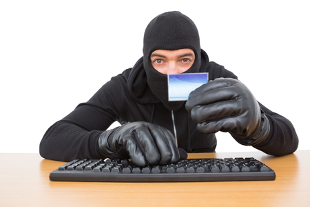 to steal: Hacker using card to steal identity on white background Stock Photo