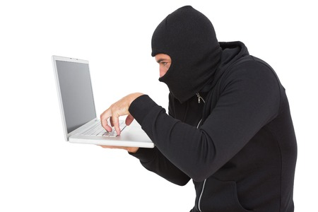to steal: Hacker using laptop to steal identity on white background