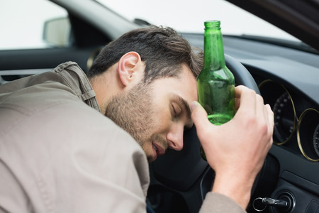 life threatening: Man drinking beer while driving in his car