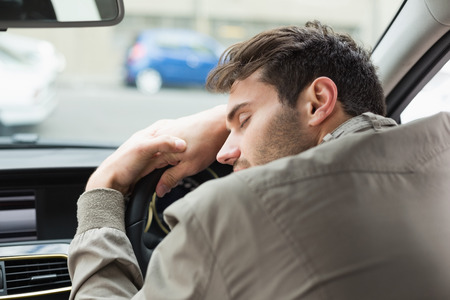 passed out: Drunk man slumped on steering wheel in his car
