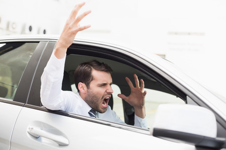 outraged: Businessman experiencing road rage in his car Stock Photo