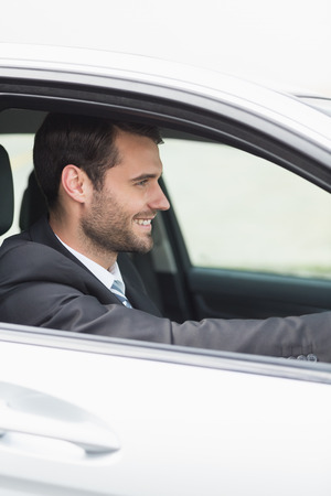 drivers seat: Happy businessman in the drivers seat in his car