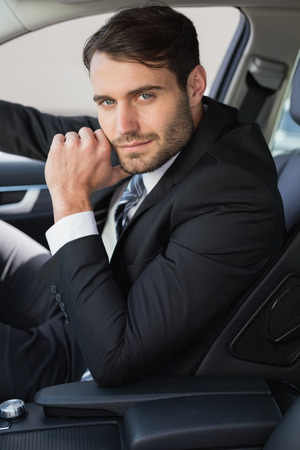 drivers seat: Businessman sitting in drivers seat in his car