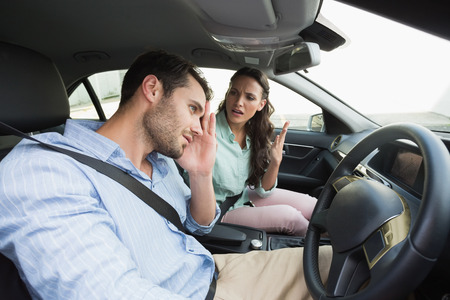 couple fight: Young couple arguing together in their car Stock Photo