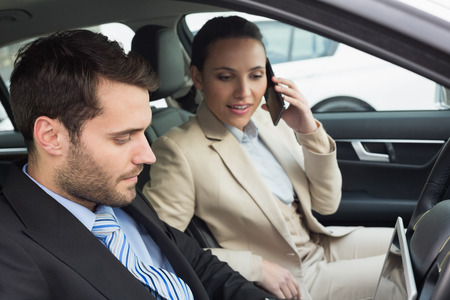 phoning: Young business team working together in the car Stock Photo