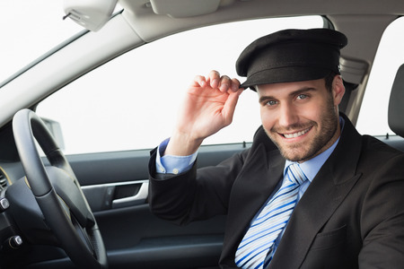 limo: Handsome chauffeur smiling at camera in the car