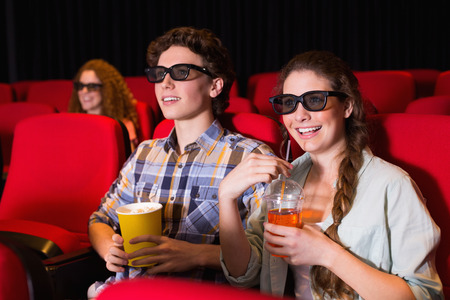 3d film: Young couple watching a 3d film at the cinema