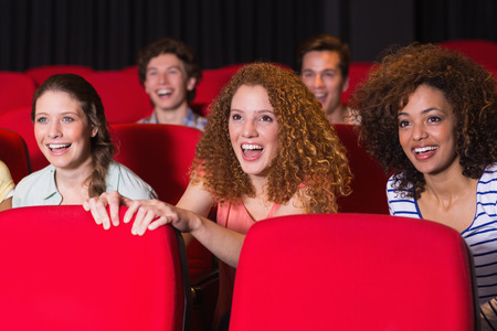 cinema people: Young friends watching a film at the cinema
