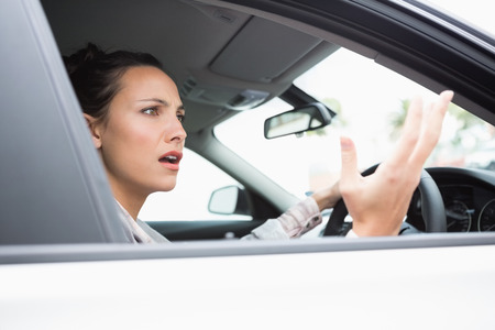 rage: Pretty businesswoman experiencing road rage in her car Stock Photo