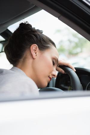 life threatening: Woman sleeping on the wheel in her car